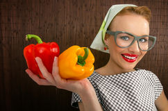 Woman cook. Funny woman cook holading sweet pepper, close up-FOCUS ON PEPPER Stock Photography