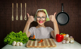 Woman cook. With okay sign cut carrot-vintage concept Royalty Free Stock Photo