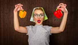 Woman cook. Funny woman cook holading sweet pepper, close up Royalty Free Stock Photo