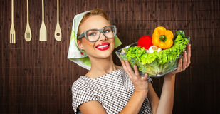 Woman cook. Rural woman cook holding bowl with vegetable, close-up Stock Image