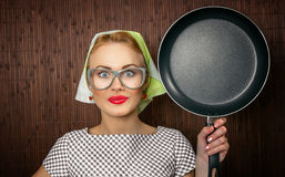 Woman cook. Close-up funny woman cook with pan - vintage concept Royalty Free Stock Photo