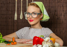 Woman cook. Close-up portrait of a rural woman cook with vegetable Stock Photos