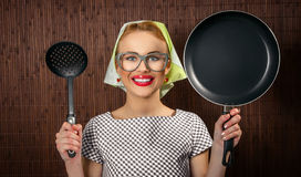 Woman cook. Close-up funny woman cook with pan and spoon - vintage concept Royalty Free Stock Photos