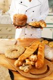 Woman cook with baked goods Royalty Free Stock Images
