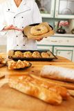 Woman cook with baked goods Stock Image