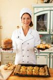 Woman cook with baked goods Stock Photo