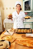 Woman cook with baked goods Royalty Free Stock Photo