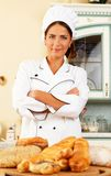 Woman cook with baked goods Royalty Free Stock Photos
