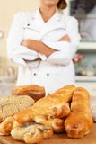 Woman cook with baked goods Royalty Free Stock Photography