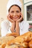 Woman cook with baked goods Stock Images