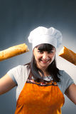 Woman cook with bread Royalty Free Stock Image