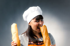 Woman cook with bread Stock Photography