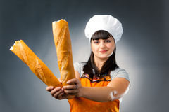 Woman cook with bread Royalty Free Stock Images