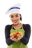 Woman cook with a bunch of cherry tomatoes Stock Photos