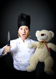 Woman cook chef with crazy ingredient. Gray background Royalty Free Stock Photography