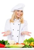 Woman cook. In chef hat with fresh vegetables, isolated on white background Stock Photo