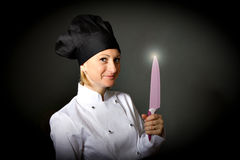 Woman cook chef with kitchen knife Stock Image