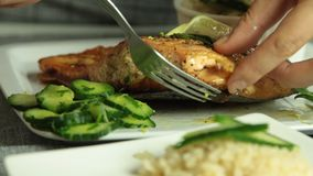Woman cooking salmon fish at home stock video footage