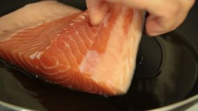 Woman cooking salmon fish at home set