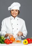 Woman cook cutting vegetables Royalty Free Stock Images