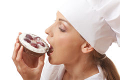 Woman cook eating cake Royalty Free Stock Image