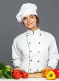 Woman cook with fresh vegetables Stock Photos