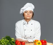 Woman cook with fresh vegetables Royalty Free Stock Photography