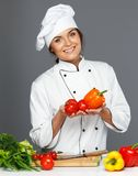 Woman cook with fresh vegetables Royalty Free Stock Images
