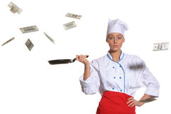 Woman-cook frying pan catches money Royalty Free Stock Image