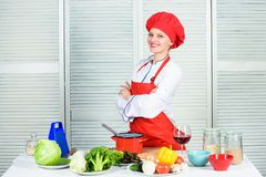 Woman in cook hat and apron. professional chef in kitchen. restaurant menu. Dieting. happy woman cooking healthy food by. Recipe. organic eating and vegetarian stock photos