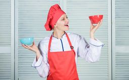 Woman cook hold bowls. How many portions would you like to eat. Calculate amount calorie you consuming. Calculate normal. Portion of food. Calculate your food royalty free stock photos