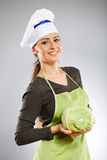 Woman cook holding a cabbage Stock Photo