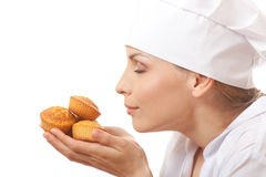 Woman cook holding cakes Stock Photo