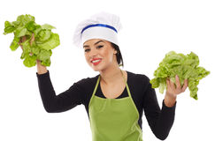 Woman cook holding lettuce Royalty Free Stock Photography