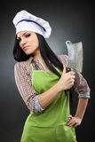 Woman cook holding a meat chopper Stock Photos