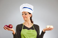 Woman cook holding red and white onions Royalty Free Stock Images