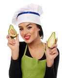 Woman cook holding sliced avocado Royalty Free Stock Photography