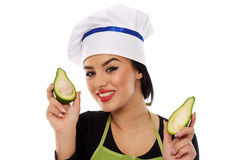 Woman cook holding sliced avocado Royalty Free Stock Images