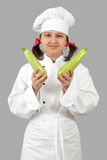 The woman the cook holds green vegetable marrows. Stock Images