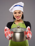 Woman cook with hot pot Royalty Free Stock Image
