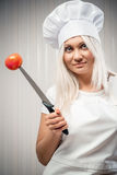 Woman cook indoors Royalty Free Stock Images