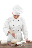 cook is occupied with dough preparation Royalty Free Stock Images