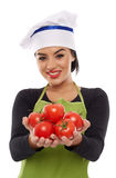 Woman cook offering freshly picked tomatoes Royalty Free Stock Photography