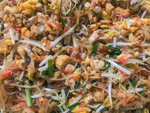 Pad Thai in the pan. Pad Thai is the most favorite and famous Asian Thai street food. Woman cook Pad Thai in the pan. Pad Thai is the most favorite and famous royalty free stock images