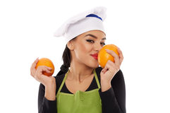 Woman cook with perfumed oranges Royalty Free Stock Images