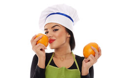 Woman cook with perfumed oranges Stock Image