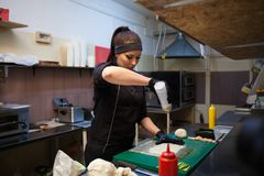 Woman Cook prepares food sushi kitchen. 1 nice Royalty Free Stock Images