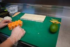 Woman Cook prepares food sushi kitchen. Nice Royalty Free Stock Image