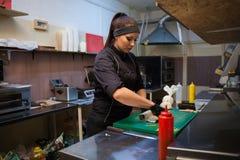 Woman Cook prepares sushi on restaurant kitchen. 1 Royalty Free Stock Photos