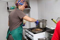 Woman cook preparing eggplants Royalty Free Stock Photos